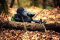 Paintball player in protective uniform and mask aiming gun in th Royalty Free Stock Photo