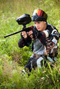 Paintball shooter aiming the gun Royalty Free Stock Photography