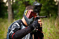 Paintball shooter in the field Royalty Free Stock Images