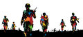 Paintball troops editable vector illustration of paint splattered soldiers walking on patrol Stock Image