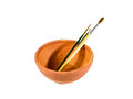 Paintbrush in bake clay bowl three small isolated Royalty Free Stock Photos