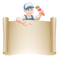 Paintbrush guy and scroll a painter decorator holding a peeking over a banner pointing Royalty Free Stock Photography