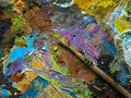 Paintbrush on the palette for mixing oil paints.