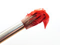 Paintbrush with red paint detail of a Royalty Free Stock Image