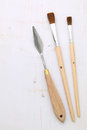 Paintbrushes and palette knife Stock Photos