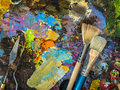Paintbrushes and palette knife on the palette for mixing oil pai paints Stock Image