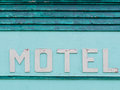 Painted blue green historic motel facade siding detail of wooden grungy Royalty Free Stock Photo