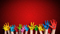 Painted children hands with smiley in front of christmas background Royalty Free Stock Photo