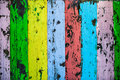 Painted colorful decaying wood of old wooden fence Royalty Free Stock Photo