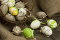 Painted Colorful Easter Eggs on wooden surface Royalty Free Stock Photo