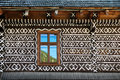 Painted decorations on wall of log house in Cicmany, Slovakia