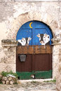 Painted door of cheese shop italy doors with cows a selling dairy produce in santo stefano di sessanio hill town in the province l Royalty Free Stock Photography