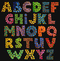 Painted dots alphabet letters bright neon hand capital on black Stock Photo