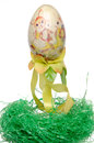 Painted easter egg on a green nest isolated white Stock Image