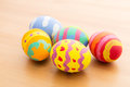 Painted easter egg on wooden table Stock Image