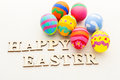 Painted easter egg and wooden text Stock Photos