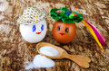 Painted egg and wooden spoon with salt. Royalty Free Stock Photo