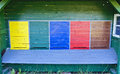 Painted entrance slots at a bee house colorful Royalty Free Stock Image