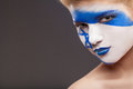 Painted face art on beautiful girl Royalty Free Stock Photography