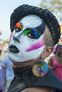 Painted face a person has a colorfully decorated as a participant in the san diego gay pride parade Stock Photography