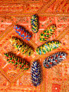 Painted fir cones on carpet Royalty Free Stock Photos