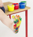 Painted foot with color tubs in background Royalty Free Stock Photos