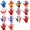 Painted hands multiple with flags on them Stock Photos