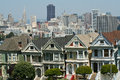 The painted ladies of alamo square at in san francisco a view skyscrapers downtown san francisco behind Stock Image