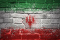 Painted national flag of iran on a brick wall Royalty Free Stock Photo