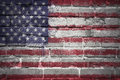 Painted national flag of united states of america on a brick wall