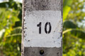 Painted number ten (10) on a concrete column Royalty Free Stock Photo