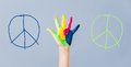 Painted peace sign in girl's hand against war. Royalty Free Stock Photo
