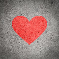 Painted red heart on dark grey concrete wall textured background grunge and cement Stock Photos