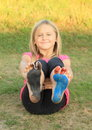 Painted soles of a little girl bare foot smiling on blue red and black Stock Photography