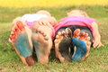 Painted soles of little girls bare feet a smiling on blue red and black Royalty Free Stock Photography