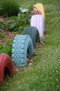 Painted tires used as a border of a flower garden Royalty Free Stock Images