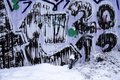 Graffiti on the wall in snow