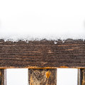 Painted wooden board and rungs covered with snow Royalty Free Stock Photo