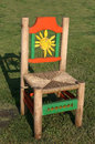 Painted wooden chair colorful with orange yellow and green Stock Photo