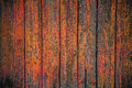 Painted wooden fence background grungy texture of an old in red see portfolio for other colors Royalty Free Stock Images