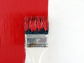 close-up paint brush painting red color on white wooden wall, renovate and decorate old house Royalty Free Stock Photo