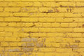Painted yellow brick wall background texture in bright tints aged street backdrop Royalty Free Stock Images