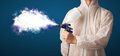 Painter with airbrush gun and white magical smoke concept Stock Photo