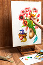 Painter drawing watercolor flowers Royalty Free Stock Photo