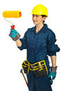 Painter female holding paint roller Stock Photo