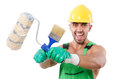 Painter in green coveralls on white Royalty Free Stock Image