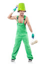 Painter in green coveralls on white Stock Images