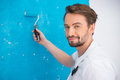 Painter holding a paint roller Royalty Free Stock Photo