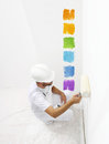Painter man with paint roller painting color samples, Royalty Free Stock Photo