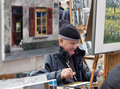 Painter painting and drawing in place du tertre in paris france Stock Images